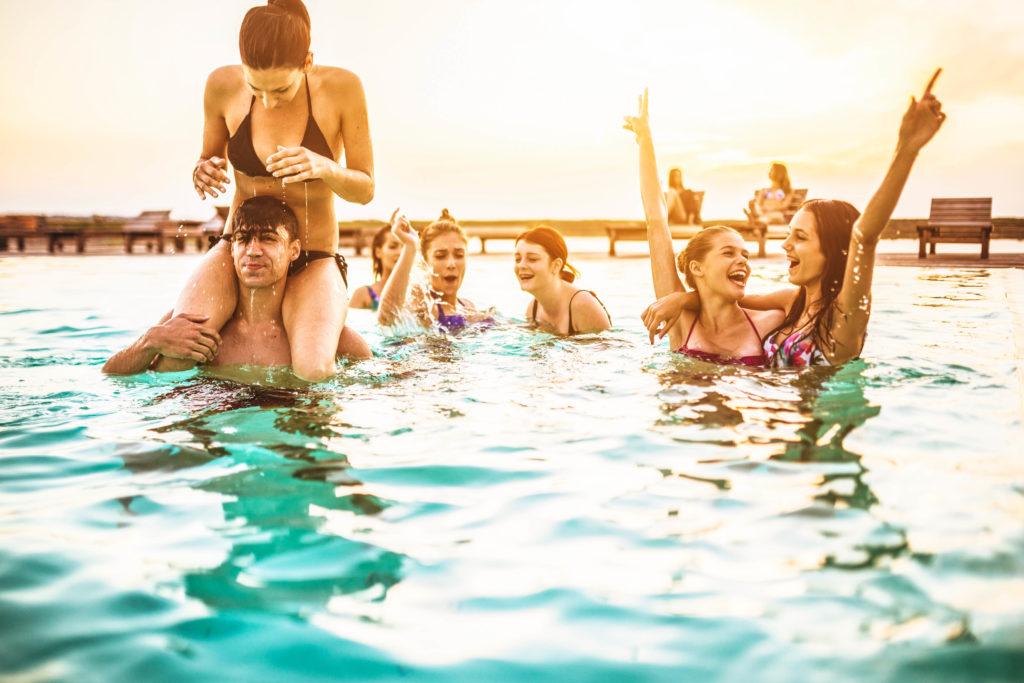 group-of-young-adult-girl-having-fun-on-swimming-pool-istock_46924358_xlarge-2